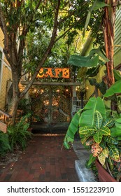 New Smyrna Beach, Florida, USA – November 2, 2019: Third Wave Cafe courtyard entrance at sunrise with lights and a tranquil jungle environment in New Smyrna Beach, Florida.