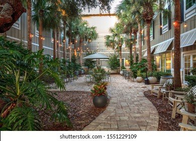 New Smyrna Beach, Florida, USA – November 2, 2019: Courtyard with lights and tables at the Hampton Inn in New Smyrna Beach, Florida at sunrise. Editorial.