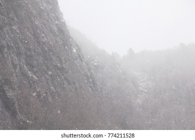 New snow. First snow fall in mountain landscape.