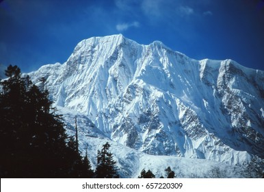 New snow on the massive mountains of the Annapurna Himal in Nepal