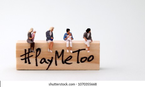 Woodenblockwritten#PayMeToo. A new social movement on the right to equal pay for women.