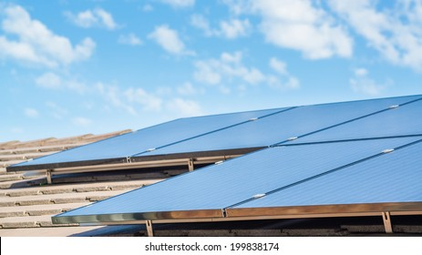 new solar panels on the roof of modern suburban house