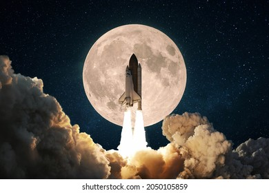 New space rocket with smoke and clouds takes off into the sky with full moon. Shuttle spaceship liftoff. Space Mission Launch Concept.