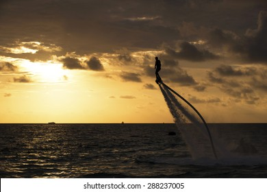 The new spectacular sport, the flyboard is showed in the coast of beach;