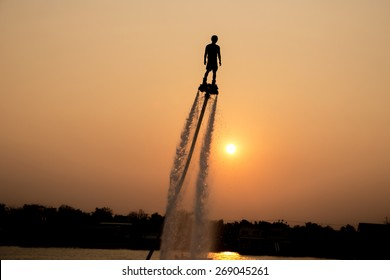 The new spectacular sport,Silhouette of man showing the fly board in the river of Thailand