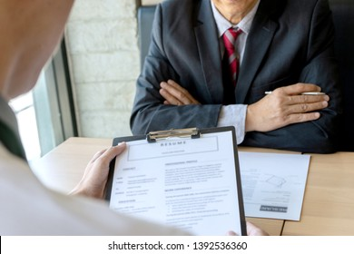 New staff candidate are in Job interview with corporate business manager arms folded in office - recruitment process concept