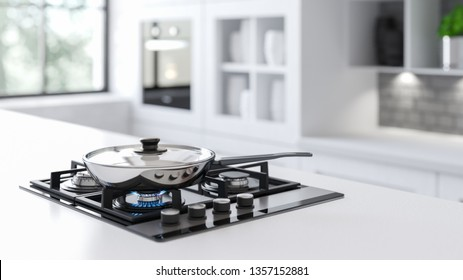 A New steel frying pan on a mirrored black gas stove in a white interior with a large window in the background. Behind The window there is a bright sun and green tree