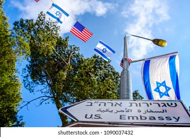 New street sign for US embassy in Jerusalem, with American and Israeli flags