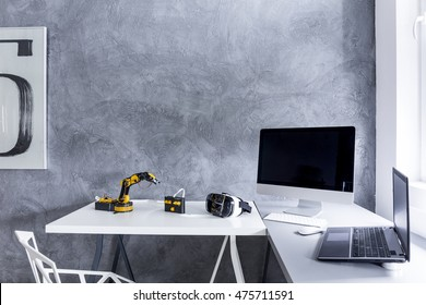 New study room with decorative wall plaster, white desk, crystal chair and computer