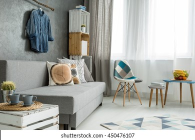 New Style Flat In Grey With Sofa, Small Table, Chair, Pattern Carpet And