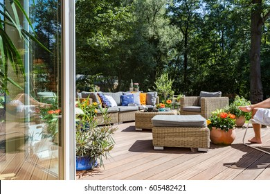 New style villa terrace with rattan furniture set and decorative flowers