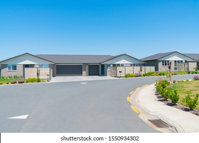 New subdivision street with uniform homes.