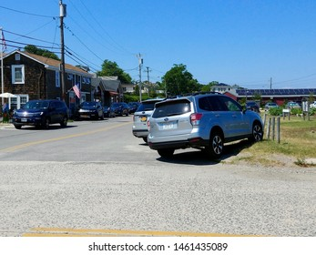 New Suffolk, NY - July 13 2019: Cars parked along First Street in downtown New Suffolk