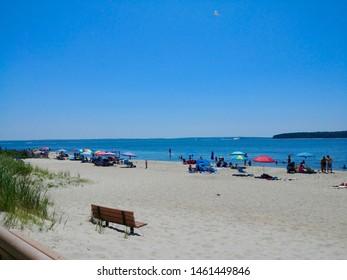 New Suffolk, NY - July 13 2019: Beachgoers enjoying a hot summer day at New Suffolk Beach