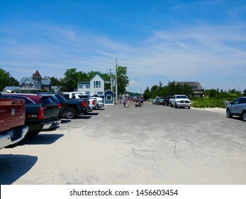 New Suffolk, NY - July 4 2019: The parking lot at New Suffolk Beach