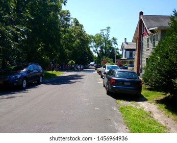 New Suffolk, NY - July 4 2019: Parked cars on a residential street in New Suffolk
