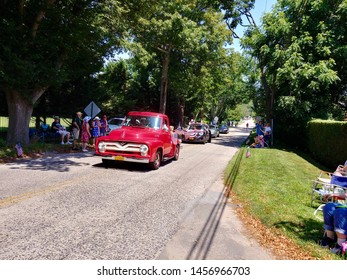 New Suffolk, NY - July 4 2019: The Fourth of July parade traveling down New Suffolk Road