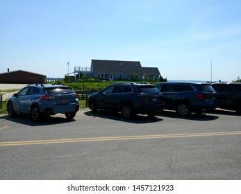 New Suffolk, NY - July 4 2019: Cars parked along First Street in downtown New Suffolk