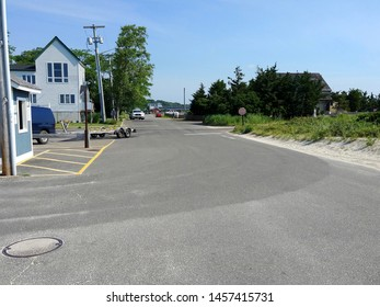 New Suffolk, NY - July 4 2019: The driveway to the New Suffolk Beach parking lot
