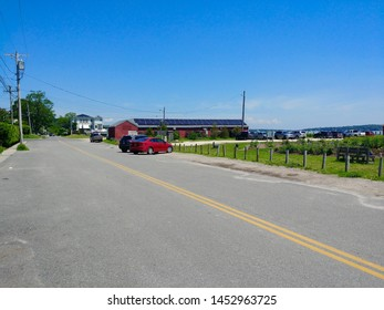 New Suffolk, NY - June 27 2019: Streetscape of First Street in downtown New Suffolk