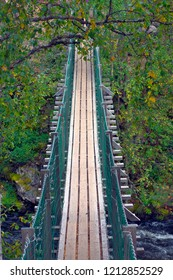 New suspension bridge in greenery  for hikers in Oulanka nature reserve, Finland.
