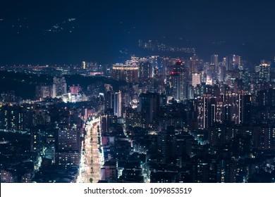New Taipei City Skyline Aerial View - Birds eye night view use the drone in Taipei, Taiwan.