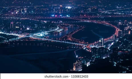 New Taipei City Skyline Aerial View - Asia business city concept image, modern cityscape building birds eye night view use the drone in New Taipei, Taiwan.