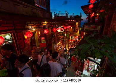 New Taipei City, Taiwan - August 7, 2018 : Beautiful Old Town Jiufen with crowd of tourists sightseeing at nighttime in New Taipei City, Taiwan on August 7, 2018.