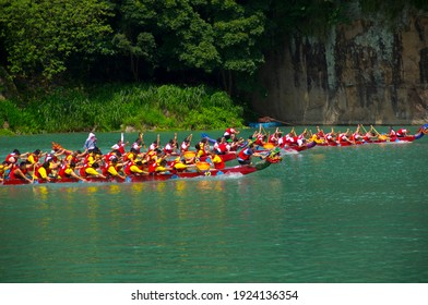 New Taipei City, Taiwan-June 6, 2011: Dragon boating on the lake during the Dragon Boat Festival.