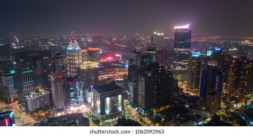 New Taipei, Taiwan - April 2, 2018: Aerial view of New Taipei City downtown skyline in evening. Panoramic cityscape birds eye view use the drone, shot in Banqiao District, New Taipei, Taiwan.