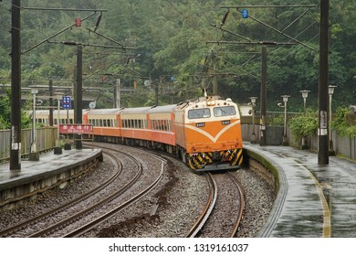 NEW TAIPEI, TAIWAN - Feb 21, 2019: Electric locomotive (Taiwan Railway E400 series) with its carriage running on a curved platform.