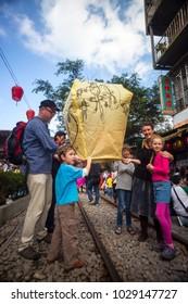 New Taipei, Taiwan - Feb 5, 2012: Tourists Launching Sky Lantern Along Railway Next to Shifen Train Station of Pingxi Line (Most Beautiful Branch Line in Taiwan Railway System)