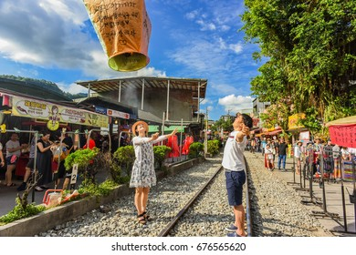 New Taipei, Taiwan - July 8, 2017: Tourists Launching Sky Lantern Along Railway Next to Shifen Train Station of Pingxi Line (Most Beautiful Branch Line in Taiwan Railway System)