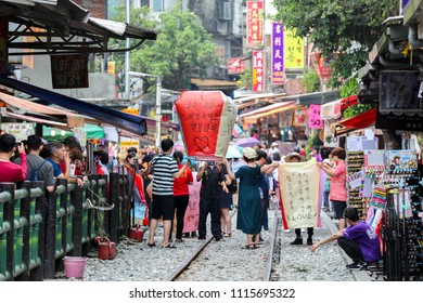 New Taipei, Taiwan - May 15, 2018: Tourists are Launching Sky Lantern Along Railway Next to Shifen Train Station of Pingxi Line (Most Beautiful Branch Line in Taiwan Railway System)
