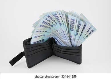 New Taiwan Dollar money in black wallet. (3)