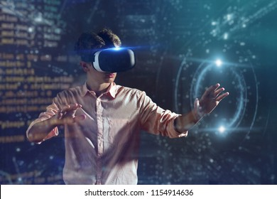 new technologies, a boy uses a futuristic processor for augmented reality. high technology and communication concept. gamer