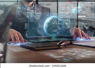 New technologies: a businessman uses a futuristic processor for augmented reality. high technology and communication concept.