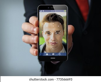 new technologies concept: businessman showing smartphone with face id technology on the screen. Screen graphics are made up.