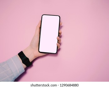new technology and e-commerce concept from hand of business woman hold and use new smart phone on pink pastel background with copy space and clipping path