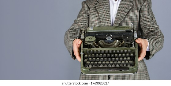 new technology in modern life. Man working on retro typewriter in library. mechanical vs digital. writer writes with typewriter. bearded man in jacket with retro type writer. copy space.