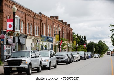 NEW TECUMSETH, CANADA - SEPTEMBER 15, 2017: MAIN STREET WITH PARKED CARS AND BUILDINGS IN SMALL TOWN, ONTARIO.