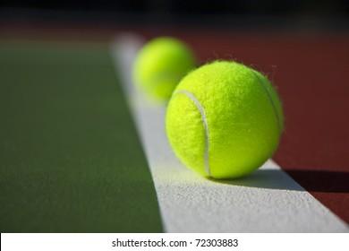 New Tennis Balls shot on  a outdoor tennis court