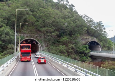 New Territories,Hong Kong- June 9, 2018: Red double deck bus and cars are passing through Shing Mun Tunnels.The tunnels are connecting the new towns of Tsuen Wan  and Sha Tin.