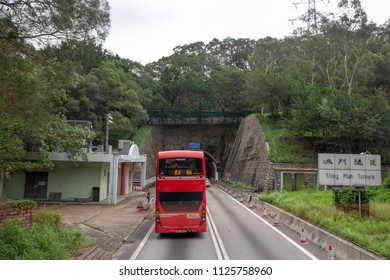 New Territories,Hong Kong- June 9, 2018: Red double deck bus pass through Shing Mun Tunnels.The tunnels are connecting the new towns of Tsuen Wan  and Sha Tin in the New Territories