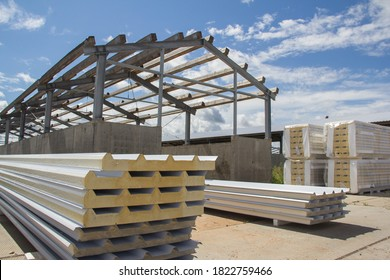 New thermal insulation sandwich panel, construction material for architecture. Sandwich panels at the construction site. New material for insulating the walls of the building under construction. - Shutterstock ID 1822759466