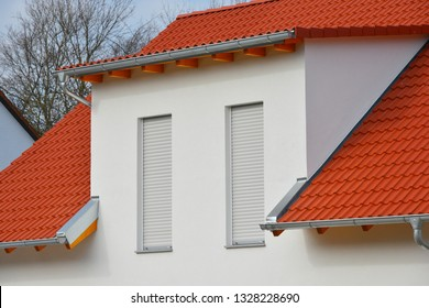 New tiled Roof with concrete Dormer Window, Rain Gutter and Rain Water Pipes