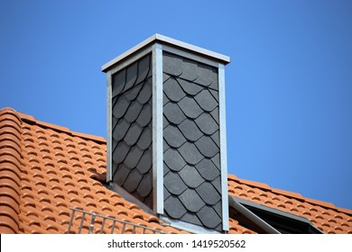 New tiled roof with slate cladded chimney