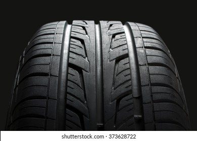 new tire, just bought , on an isolated dark background