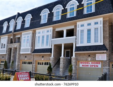New townhomes with sold sign
