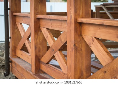 New treated pine handrails on the gazebo fencing. Building.